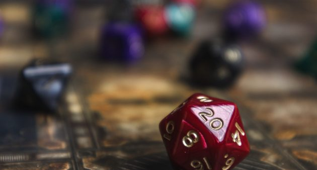 Red d20 die showhing a 20. Role playing dice. Dungeons and Dragons style dice.